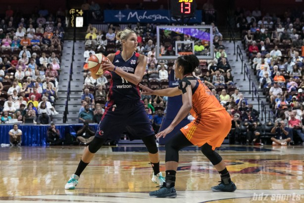 Washington Mystics forward Elena Delle Donne (11) controls the ball while being defended by Connecticut Sun forward Alyssa Thomas (25).