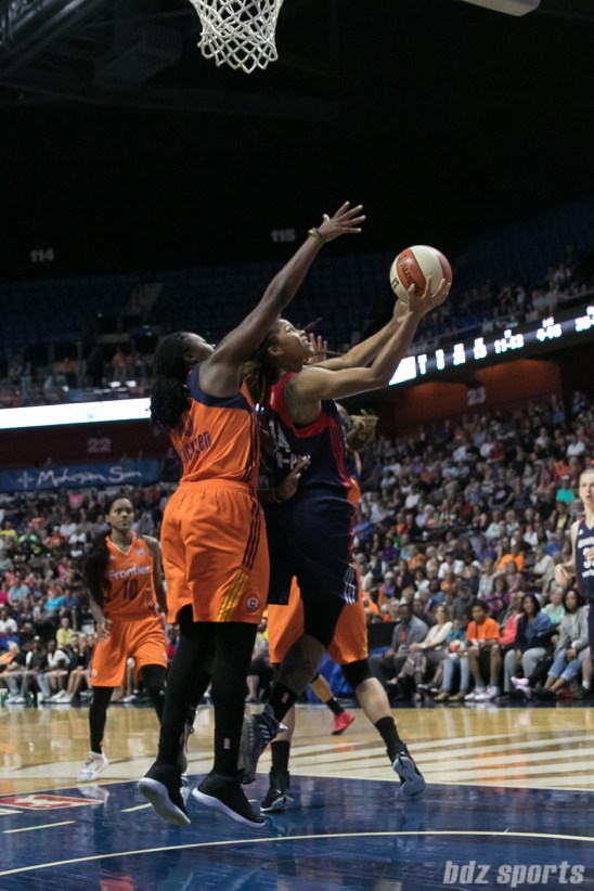 Washington Mystics guard Tierra Ruffin-Pratt (14) looks to reverse lay in the ball while being defended by Connecticut Sun forward Shekinna Stricklen (40).