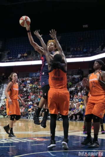 Washington Mystics forward Tianna Hawkins (21) dishes off a pass.
