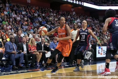 Connecticut Sun guard Jasmine Thomas (5) steals the ball in front of the Connecticut bench.