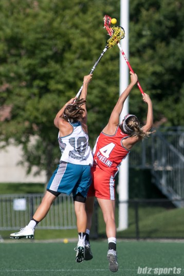 Philadelphia Force Carly O'Connell (10) challenges Boston Storm midfielder Vicki Gaveline (4) for a ball in the air.