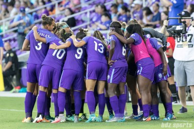 The Orlando Pride huddle before the start of the game.