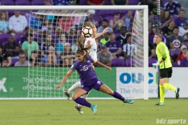 FC Kansas City defender Becky Sauerbrunn (4) battles U.S. National Team teammate Orlando Pride forward Alex Morgan (13) for the ball.