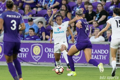 FC Kansas City forward Sydney Leroux (14) takes on Orlando Pride defender Alanna Kennedy (14) with teh ball.