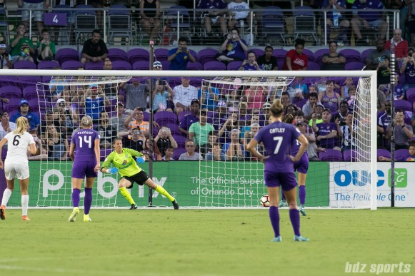 FC Kansas City goalkeeper Nicole Barnhart (18) guesses the wrong way as Orlando Pride forward Alex Morgan's ball goes in the other direction.