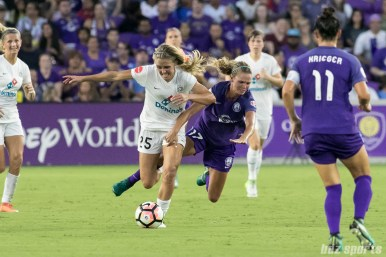 Orlando Pride midfielder Dani Weatherholt (17) challenges FC Kansas City forward Brittany Ratcliffe (25) for the ball, fouling Ratcliffe in the process.