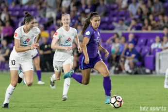Orlando Pride forward Alex Morgan (13) gets past the FC Kansas City backline.