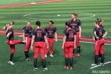 Members of the Akron Racers warm up playing hacky sack.