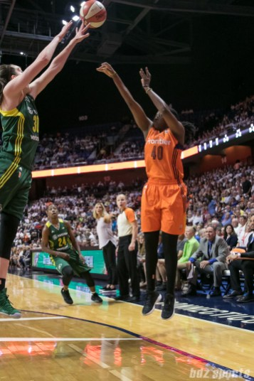 Seattle Storm forward Breanna Stewart (30) manages to get her fingertips on the 3-point shot attempt by Connecticut Sun forward Shekinna Stricklen (40).