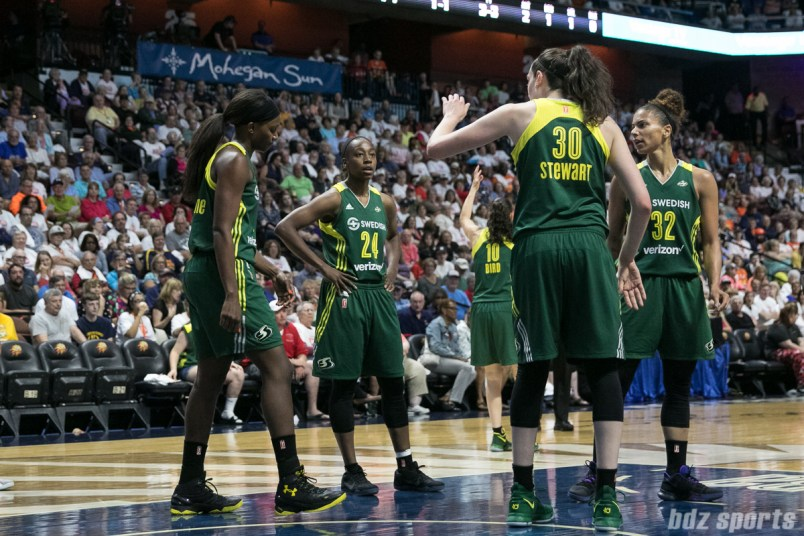 Seattle Storm players Crystal Langhorne (1), Jewell Loyd (24), Breanna Stewart (30) , and Alysha Clark (32) discuss things over after a foul call.