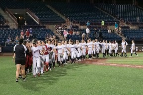 The USSSA Pride and Akron Racers shake hands after their July 16, 2017 game at Space Coast Stadium in Melbourne, Florida.