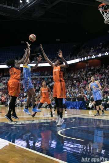 Chicago Sky forward Tamera Young (1) looks to float in a basket over Connecticut Sun center Jonquel Jones (35).