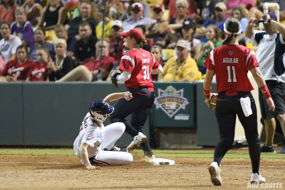 USSSA Pride infielder Shelby Pendley (2) slides into third base but is unable to beat the throw