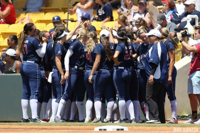 The USSSA Pride huddle and cheer prior to the start of game 2 of the NPF Championship Finals