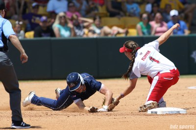 Scrap Yard Dawgs second baseman Hannah Flippen (1) makes the tag for the out