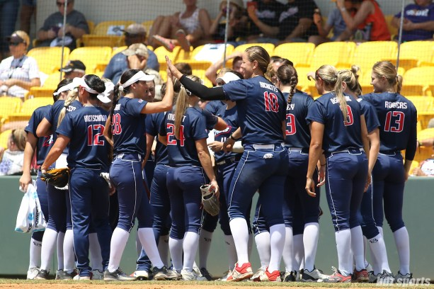 USSSA Pride pitcher Keilani Ricketts (10) high fives teammate Andrea Duran (28) after the bottom of the inning
