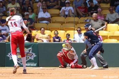 USSSA Pride designated hitter Lauren Chamberlain (44) faces Scrap Yard Dawgs pitcher Monica Abbott (14)