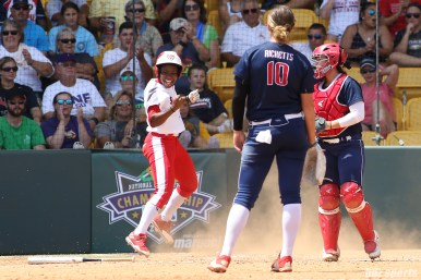 Scrap Yard Dawgs pinch runner Kiki Stokes (6) celebrates after scoring the Dawgs' second run in the inning