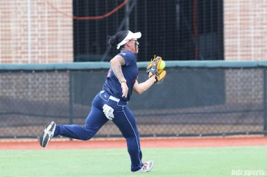 USSSA Pride outfielder Kelly Kretschman (12) makes a catch for the out