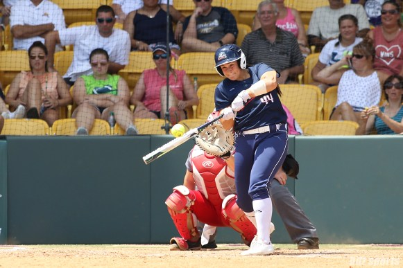 USSSA Pride designated hitter Lauren Chamberlain (44) makes contact with the bal