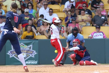 Scrap Yard Dawgs outfielder Kayla Winkfield (9) gets hit by a pitch from USSSA Pride pitcher Keilani Ricketts (10)
