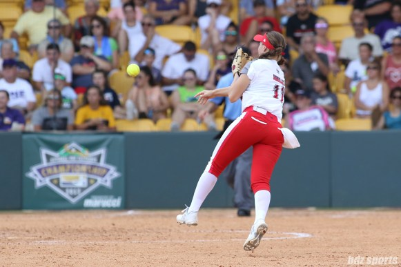 Scrap Yard Dawgs shortstop Ali Aguilar (11) makes a throw to first base