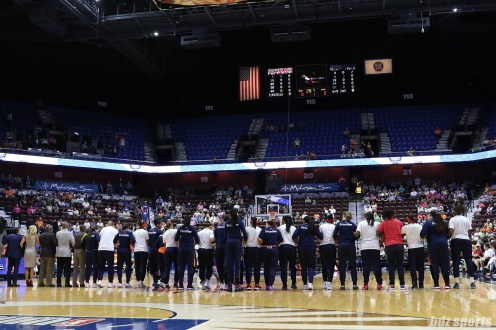 Players from the Connecticut Sun and Dallas Wings lock arms and observe a moment of silence reflecting the recent events in Charlottesville prior to their game on August 23, 2017