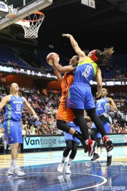 Dallas Wings guard Allisha Gray (15) attempts to slow down Connecticut Sun forward Alyssa Thomas (25) going in for a lay up