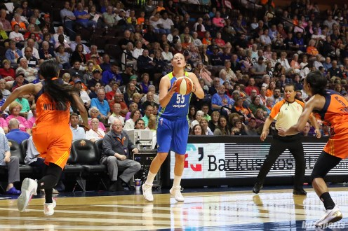 Dallas Wings forward Theresa Plaisance (55) sets up to release a 3-point shot