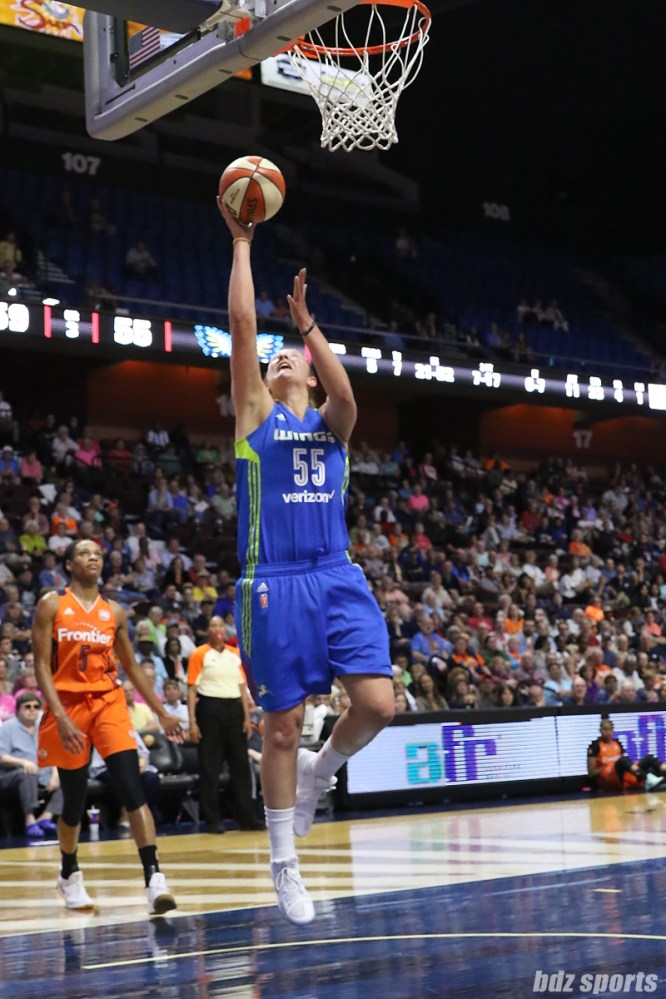 Dallas Wings forward Theresa Plaisance (55) finds an opening in the Connecticut Sun defense to score an uncontested layup