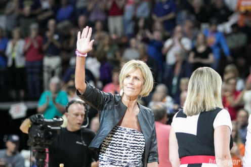 UCONN women's basketball assistant coach Chris Dailey waves to the fans after being awarded the Margo Dydek Award during the August 8, 2017 Connecticut Sun versus Seattle Storm WNBA game.