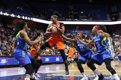 Connecticut Sun forward Alyssa Thomas (25) brings in a rebound