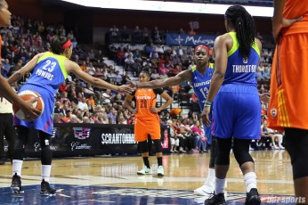 Dallas Wings forward Karima Christmas-Kelly (13) shakes hands with teammates Aerial Powers (23) and Kayla Thornton (6) after making the first of her two free throws