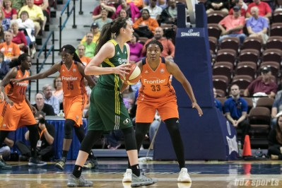 Connecticut Sun forward Morgan Tuck (33) defends former UCONN teammate Seattle Storm forward Breanna Stewart (30).