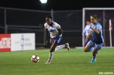 Boston Breakers forward Ifeoma Onumonu (22) brings the ball down the field while Sky Blue FC defender Erica Skroski (8) gives chase