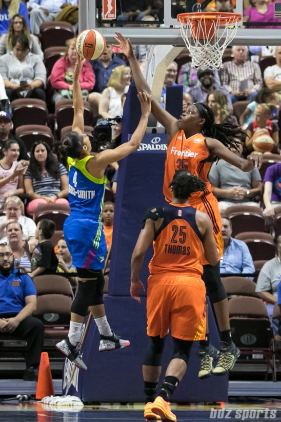 Connecticut Sun center Jonquel Jones (35) jumps up to block the layup from Dallas Wings guard Skylar Diggins-Smith (4).