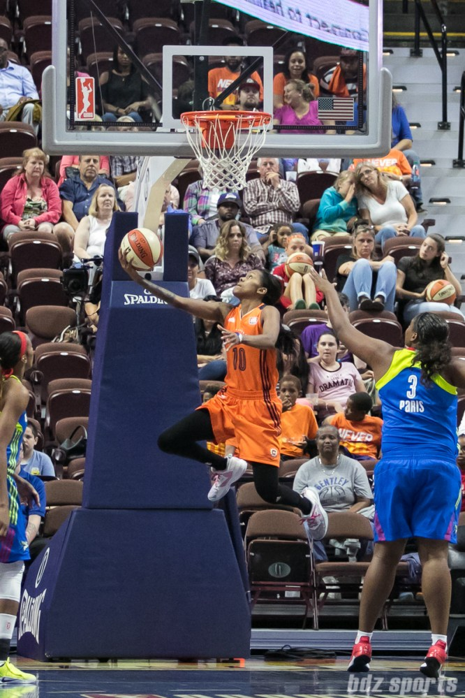 Connecticut Sun guard Courtney Williams (10) goes for the reverse layup against the Dallas Wings.