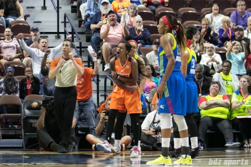 Connecticut Sun guard Courtney Williams (10) is fired up after her basket counts and draws the foul.