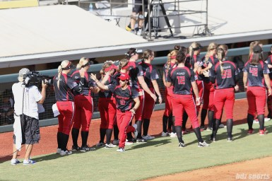 Akron Racers Kelley Montalvo (10) high fives teammates during starting lineup announcements