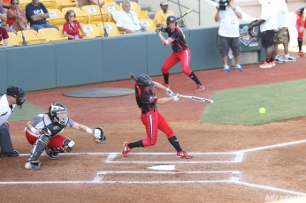 Akron Racers outfielder Shellie Robinson (3) makes contact with the ball.