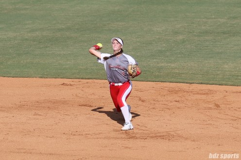 Scrap Yard Dawgs shortstop Ali Aguilar (11) makes a throw to first