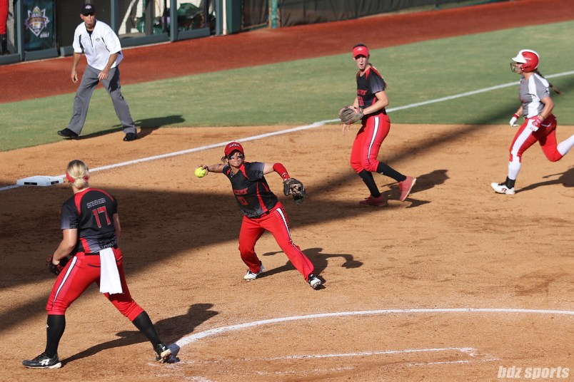 Akron Racers third baseman Kelley Montalvo (10) makes a throw to first