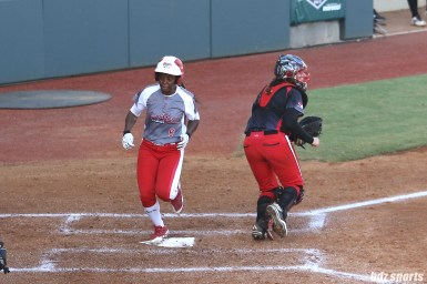 Scrap Yard Dawgs outfielder Kiki Stokes (6) scores for the Dawgs