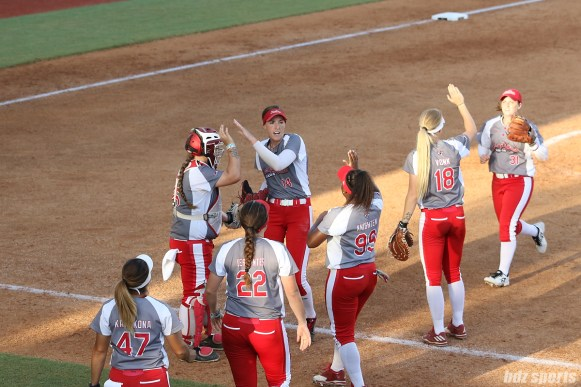 Scrap Yard Dawgs pitcher Monica Abbott (14) high fives catcher Taylor Edwards (25)
