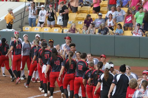 The Akron Racers and Scrap Yard Dawgs shake hands after the Dawgs defeated the Racers 4 - 3 to advance to the 2017 NPF Championships.