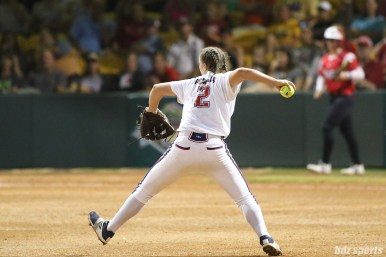 USSSA Pride shortstop Shelby Pendley (2) makes athrow to first to get the out