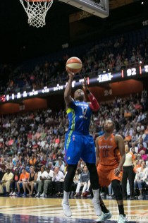 Dallas Wings forward Karima Christmas-Kelly (13) looks to lay in a basket.