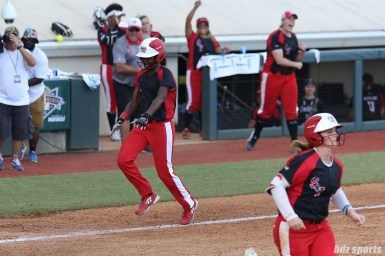 Scrap Yard Dawgs outfielder Kayla Winkfield (9) scores for the Dawgs after a walk with bases loaded