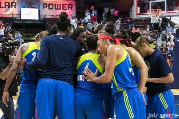 The Dallas Wings huddle post-game after losing to the Connecticut Sun 88-96.