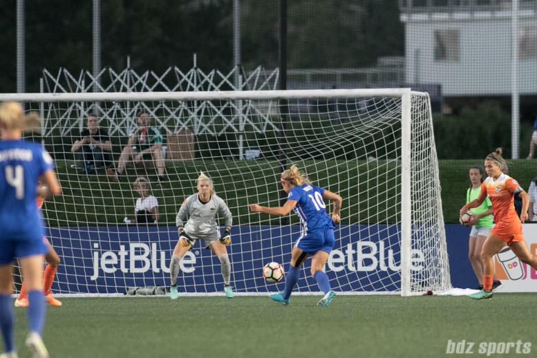 Boston Breakers midfielder Rosie White (10) takes a shot on goal against Houston Dash goalkeeper Jane Campbell (1).